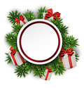 Round paper christmas card with gift boxes white red over green tree branches vector illustration Royalty Free Stock Photography
