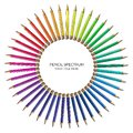 Round pattern of bright color spectrum pencils on white background