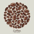 Round pattern of roasted brown coffee grains on a light background