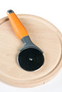 Round pizza knife on the round wooden cutting board Royalty Free Stock Photo