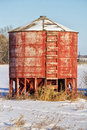 Round red wood grain bin painted storage with attached ladder Stock Photography