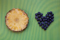 Round slice of fresh pineapple and blueberries Royalty Free Stock Photo