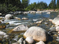 Round stones in a winding  river Royalty Free Stock Photos