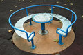 Round table in the park for kids Royalty Free Stock Photos