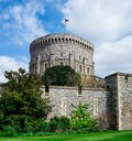 Round Tower with a raised flag in Windsor Castle, England Royalty Free Stock Photo