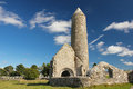 Round tower and temple clonmacnoise ireland the finghin or finian mccarthys s church in the medieval monastery of Royalty Free Stock Photography