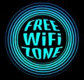 Round vector neon icon labeled free Wi fi zone on a black backgr