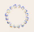 Round vintage frame made of small blue flowers on a white background with space for text