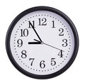 Round wall clock shows five to nine