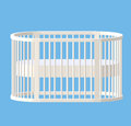 Round white cot. Baby Crib. Modern nurse design. Vector illustration isolated.