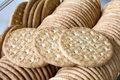 Round whole wheat crackers macro stacked in glass container Stock Photo
