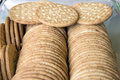 Round whole wheat crackers stacked in glass container Stock Photos