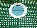 Round window on green Royalty Free Stock Photo