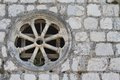 Round window in an old stone wall Royalty Free Stock Photo