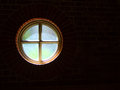 Round window a surrounded by black with light shining through Royalty Free Stock Photography