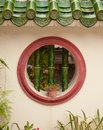 Round window in wall Stock Photography