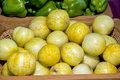 Round yellow vegetables in a basket at a market Royalty Free Stock Photo