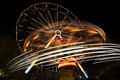 Roundabout blurs and color effects created by the ferris wheel and at the amusement park Stock Photo