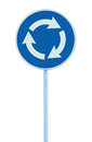 Roundabout crossroad road traffic sign isolated, blue, white arrows pointing left hand, large detailed closeup Royalty Free Stock Photo