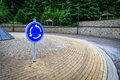Roundabout indicated by blue sign Royalty Free Stock Image