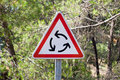 Roundabout traffic sign triangle on nature background Stock Photography