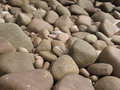 Rounded beach boulders granite above high tide level on tropical Royalty Free Stock Photo