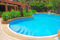 Rounded blue pool of a condominium with greens property in kuala lumpur Stock Photography