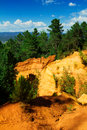Roussillon ochre mines deep yellows and oranges in the in france Royalty Free Stock Photos