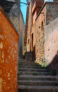 Roussillon one of the beautiful narrow red streets of the ochre city provence Stock Image