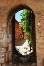 Roussillon village france houses behind an arc in historical ocher of provence Stock Image