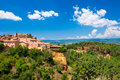 Roussillon village near gordes provence france beautiful summer landscape with red ochre cliffs and cloudy blue sky Stock Image