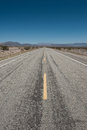 Route in the depths of the mojave desert in arizona the famous american mother road stretches for forever into the diminishing Stock Images