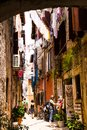 Rovinj, Croatia-June 25, 2017: Narrow Street With Hanging Clothes.