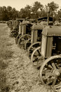 Row of Antique Tractors Sepia Royalty Free Stock Images
