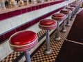 Diner counter red stools Royalty Free Stock Photo
