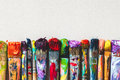 Row of artist paintbrushes closeup on canvas. Royalty Free Stock Photo