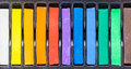 Row of artistic watercolor or pastel crayons. Royalty Free Stock Photo