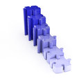 Row of ascending jigsaw puzzle some blue pieces Stock Photo