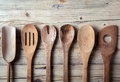 Row of assorted old wooden kitchen utensils Royalty Free Stock Photo