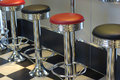 row of bar stools Royalty Free Stock Photo