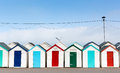Row of beach huts with colourful red blue and green doors Royalty Free Stock Photo