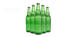 Row of beer bottles is cool on white Stock Photos