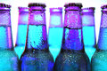 Row of beer bottles isolated Stock Photo