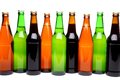 A row of beer bottles six on white background with reflection Stock Photography