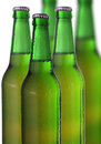 Row of beer bottles on a white Royalty Free Stock Photo