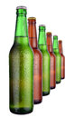Row of beer bottles on a white Royalty Free Stock Photography