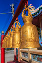 Row of bells at chinese shrine payoon beach in rayong province thailand Royalty Free Stock Image