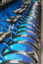 Row of bikes for hire blue Royalty Free Stock Photos