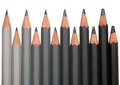 Row of black graphite pencils with different hardness colored from light grey to Stock Image