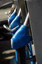 Row of blue gas pump nozzles Stock Images
